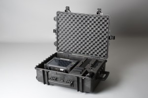 Transport case with PECT instrument, batteries and chargers