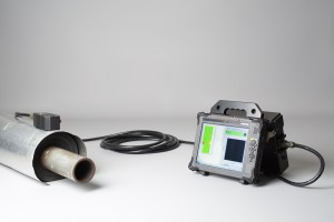 PECT instrument with cable and probe on top of insulated pipe